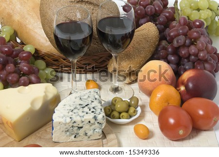 Wine, bread, cheese, fruit and vegetables