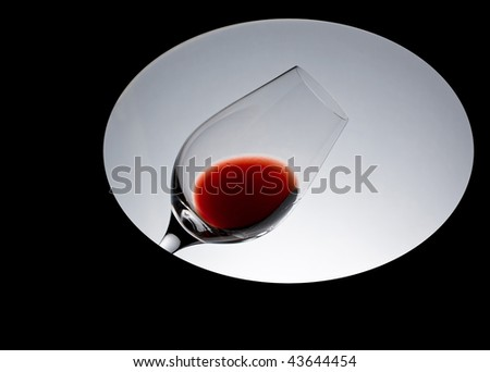 Wine by the glass - red. Visualization as part of a wine tasting procedure. - stock photo