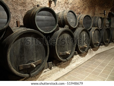 Wine cask in the dark winery basement - stock photo