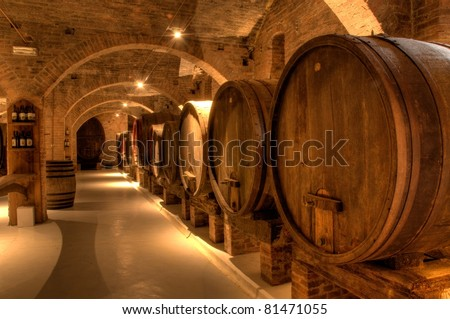 Wine cellar in the Benedictine Abbey of Monte Oliveto Maggiore, large monastery in Tuscany, Italy - stock photo