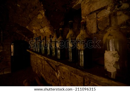 wine cellar with old wine bottles - stock photo