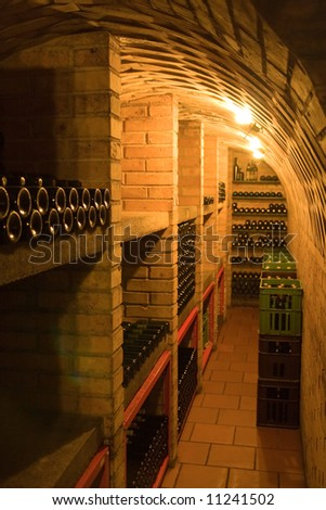 wine cellar with stacked bottles - stock photo