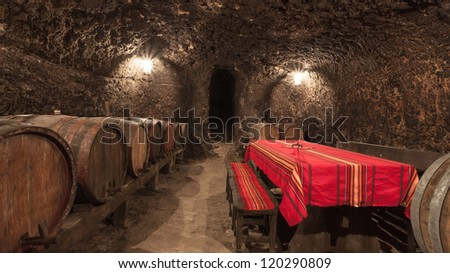 Wine cellar with table and benches in Melnik, Bulgaria. - stock photo