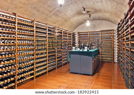 Wine cellar with wine bottle and glasses  - stock photo