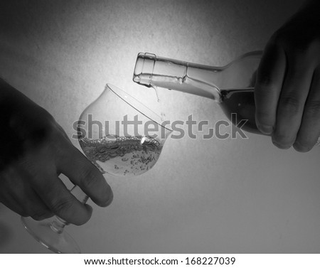 Wine charging into wine glass  - stock photo