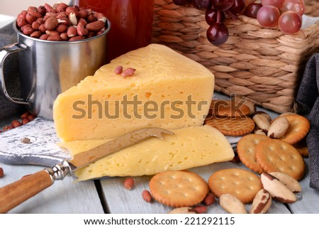 Wine, cheese and crackers on wooden table close-up - stock photo