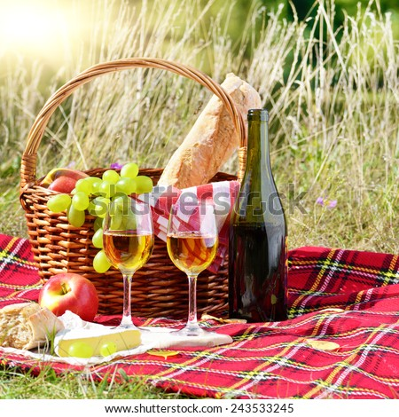 Wine cheese bread and fruits - outdoor picnic concept - stock photo