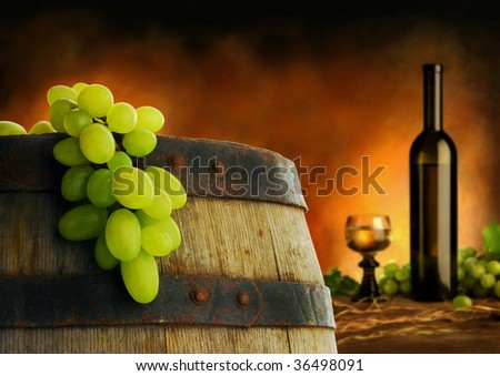 Wine composition in dark interior - stock photo