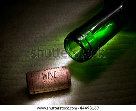 Wine cork and green bottle - stock photo
