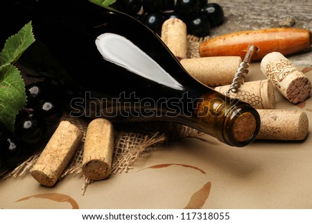 Wine Cork, Corkscrew and red wine stains on the  paper background - stock photo