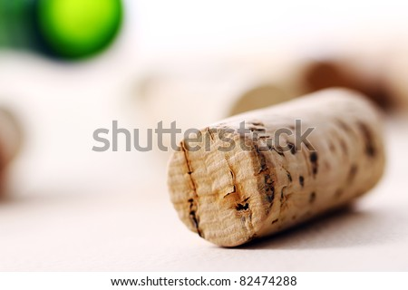 Wine corks, bottle and glass on the table - stock photo
