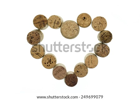 Wine corks form a heart shape image isolated on white - stock photo
