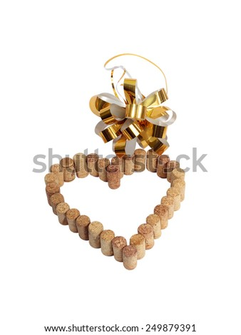 wine corks in the form of heart and a golden celebratory bow, white background - stock photo