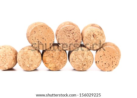 Wine corks in two rows. Isolated on a white background. - stock photo