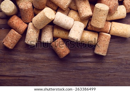 Wine corks on rustic wooden table background - stock photo