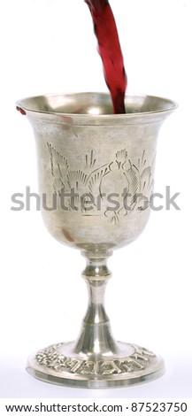 Wine cup used for jewish Kiddush. - stock photo