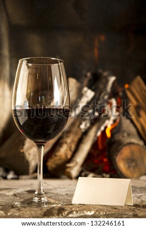 Wine cups, grapes and fire on the background. - stock photo