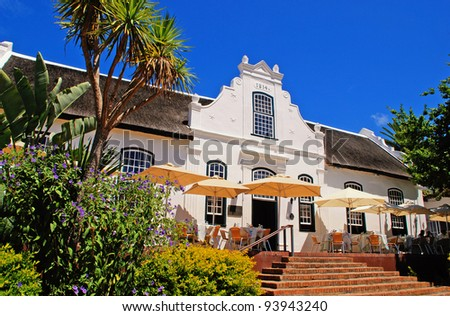 wine farmhouse in colonial style (South Africa) - stock photo
