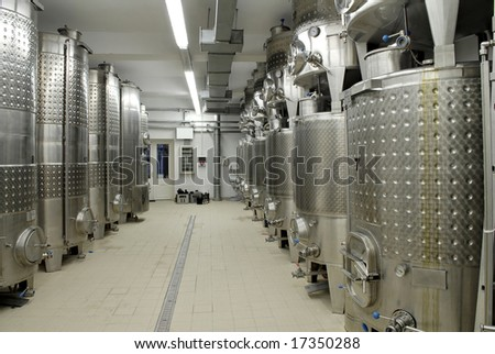 Wine fermentation in stainless steel tank - stock photo