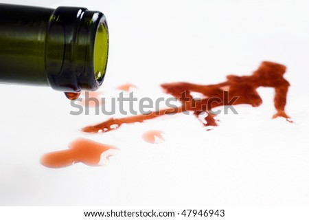 wine flows from goblet and turn into a sexy woman pattern - stock photo