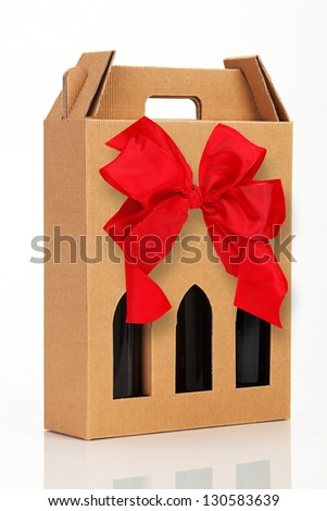Wine gift box with red bow. - stock photo