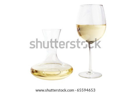 Wine glass and a carafe filled with white wine, isolted on white - stock photo