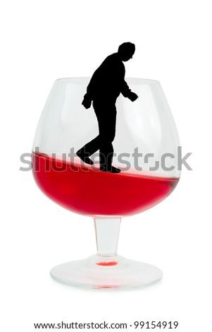 Wine glass and alcoholic man isolated on white background - stock photo