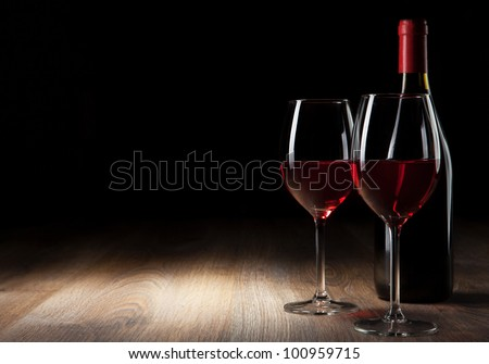 Wine glass and Bottle on a wooden table
