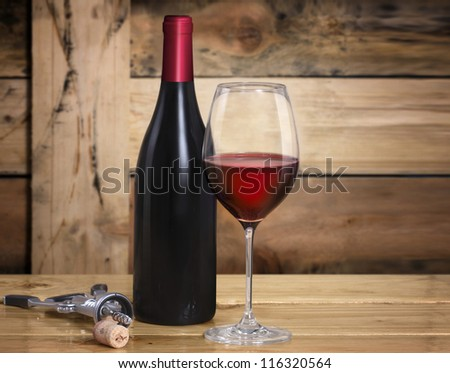 Wine glass and Bottle on wooden background