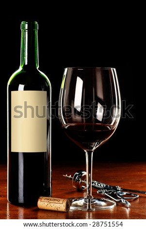 Wine glass and bottle with blank label for buyer message