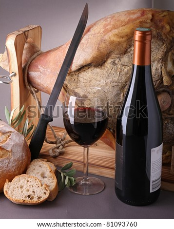 wine, glass and bottle with serrano ham and bread