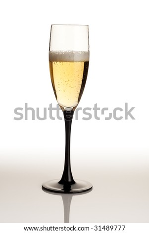 Wine glass and sparkling wine over white backround
