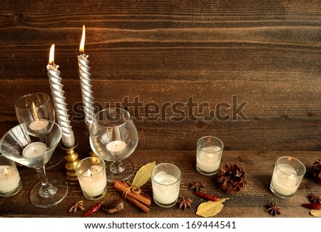Wine glass,candle and spice.image of party on winter and autumn season.