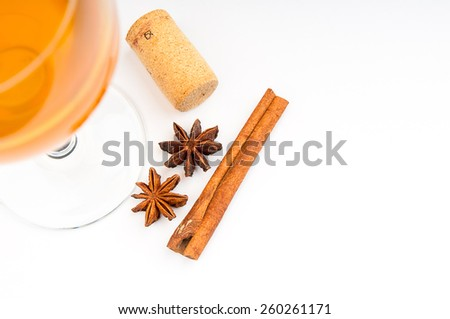 Wine glass, cork and cinnamon on white background - stock photo