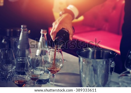 Wine glass degustation catering services background with glasses of wine on bartender counter in restaurant