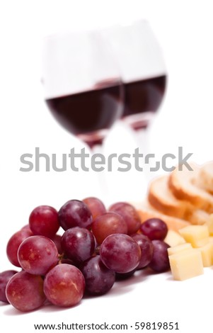 Wine glass, grapes, cheese and bread , isolated