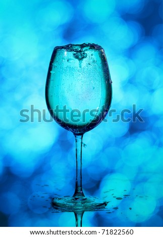 Wine glass in front of defocused lights