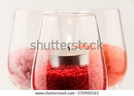 Wine glass isolated on a white background with spa salt inside / Colored romantic aromatic bath salt background / dead sea salt / happy valentine's day close up wineglass / close up seamless - stock photo