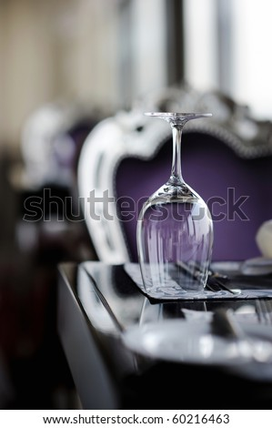 Wine glass on a table - stock photo