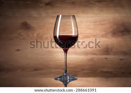 Wine glass on a wooden background