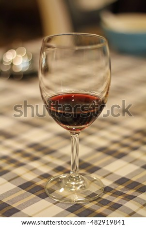 Wine glass on table background