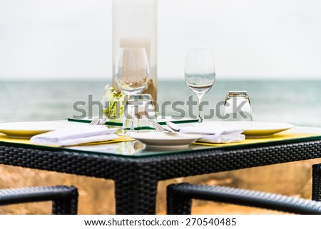 Wine glass on table in restaurant - stock photo