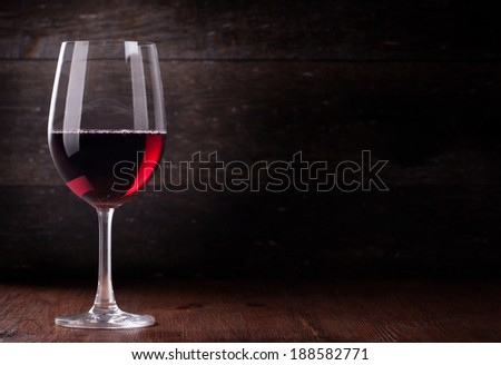 Wine glass on the background of the bar - stock photo