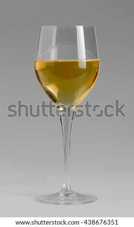 wine glass partly filled with white wine in grey back - stock photo