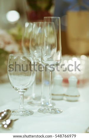 wine glass setup on the table in luxury dinner party, Blurry background with vintage color style.