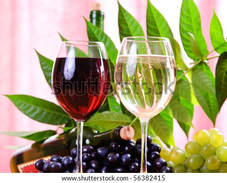 Wine glass with bottle of wine - stock photo