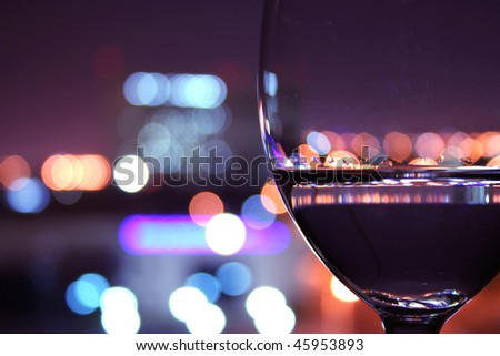 wine glass with light bokeh in background - stock photo