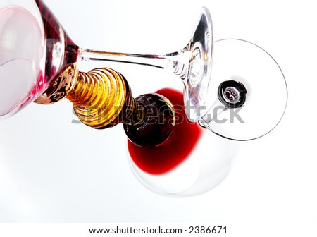 Wine Glass with red wine leaning on golden glass