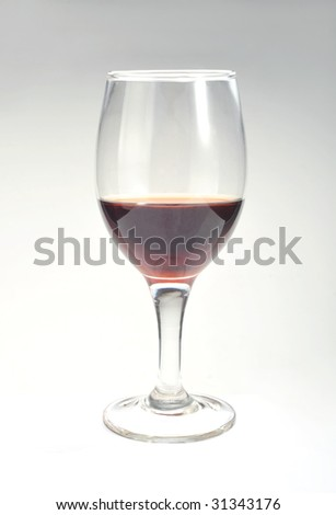 Wine glass with red wine on a white background - stock photo