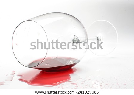 Wine glass with splash isolated - stock photo